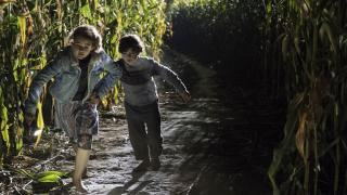 The kids of A Quiet Place run for their lives through a cornfield at night