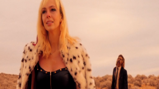 Brittany Allen is pursued by a lone zombie in It Stains the Sands Red