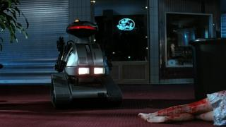 One of the robots lurks near a fresh kill in Chopping Mall